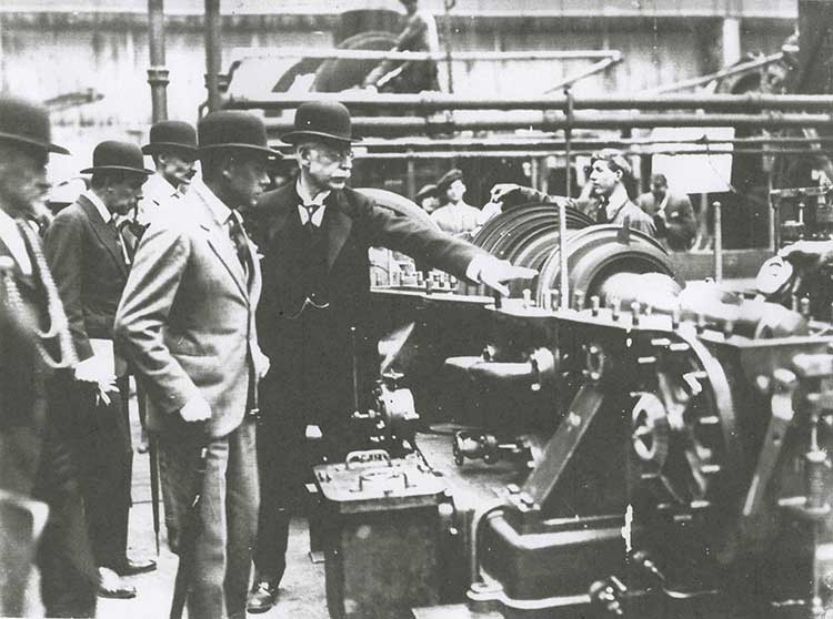 Charles Parsons shows off the steam turbine during a royal visit to Heaton in 1923
