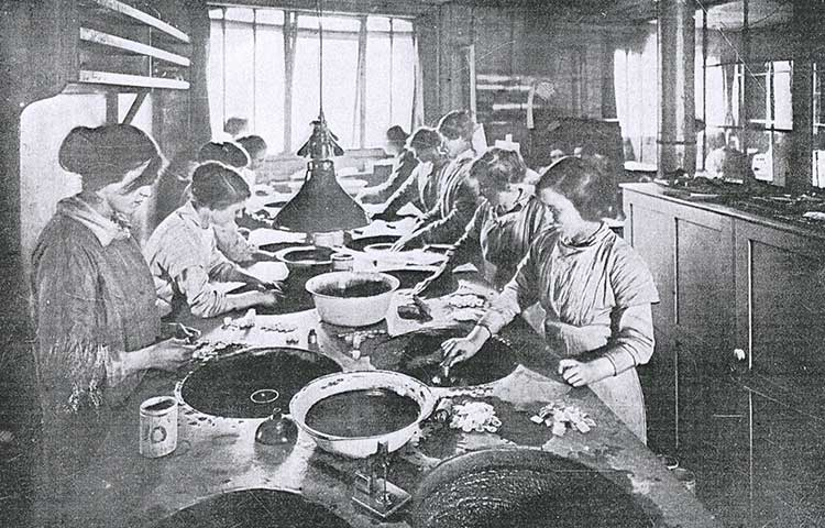 Women grinding lenses